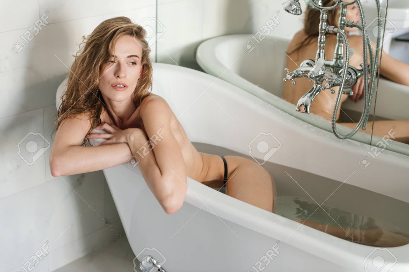 Naked woman in bath